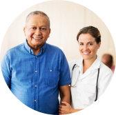 caregiver and senior man looking at the camera while smiling