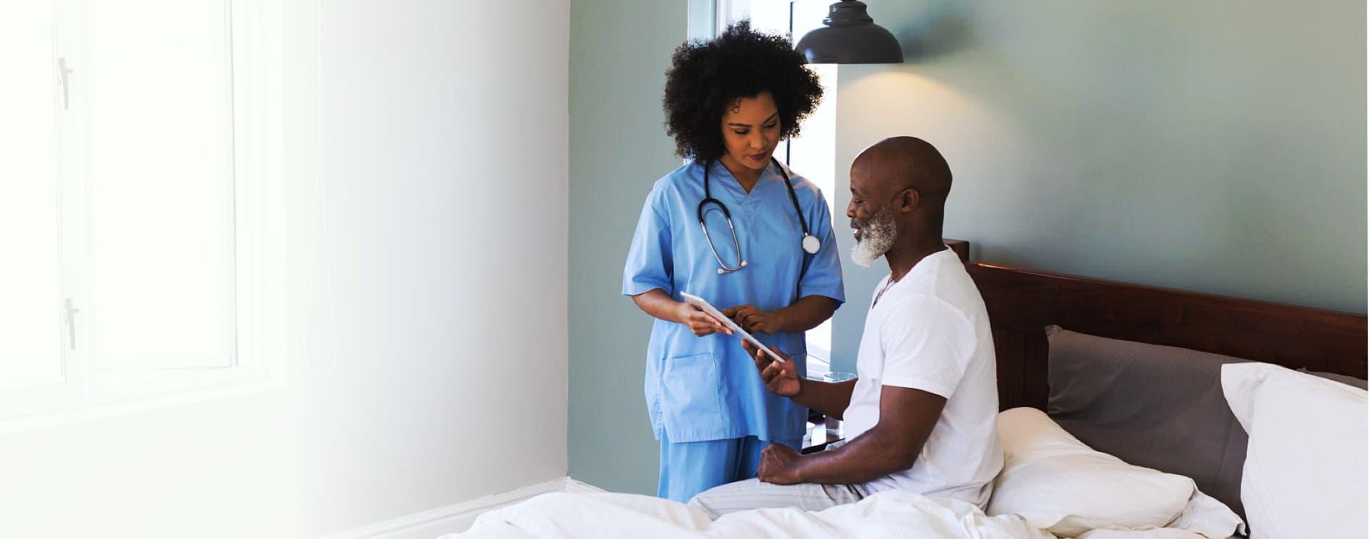 nurse and senior man talking