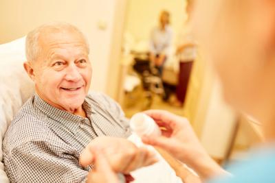 senior man looking his caregiver