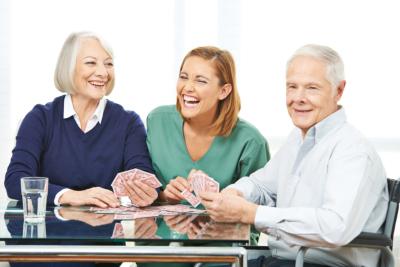 senior couple with their caregiver smiling