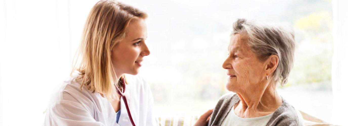 nurse smiling at the senior woman
